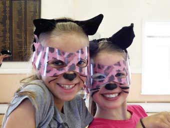 Two little cats dressed for the performance
